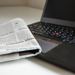 Image of newspaper sitting on a computer